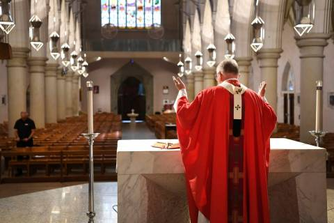 Archbishop Mark Coleridge delivers a Good Friday mass to an empty St. Stephen's Cathedral in Br ...