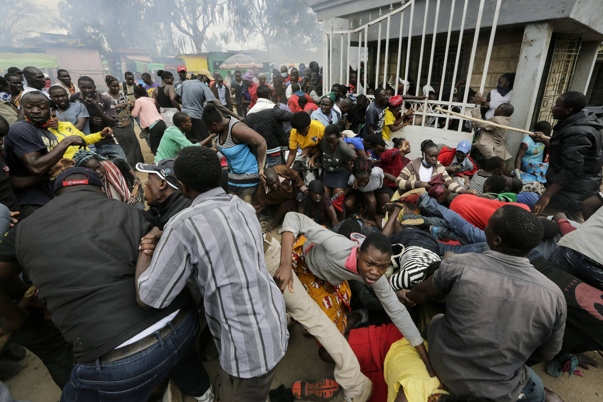 Residents desperate for a planned distribution of food for those suffering under Kenya's corona ...