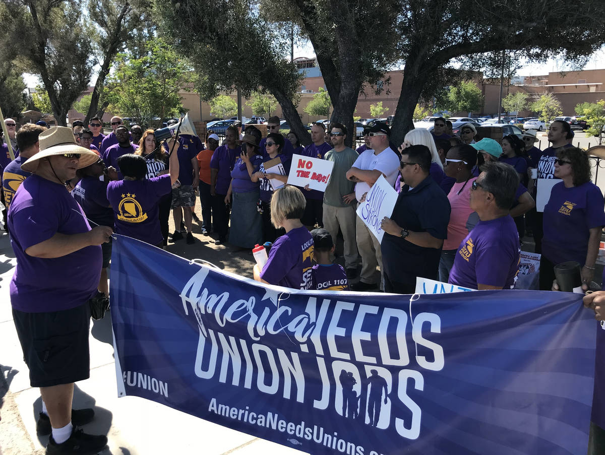 Members of the Service Employees International Union picket outside the Las Vegas Review-Journa ...