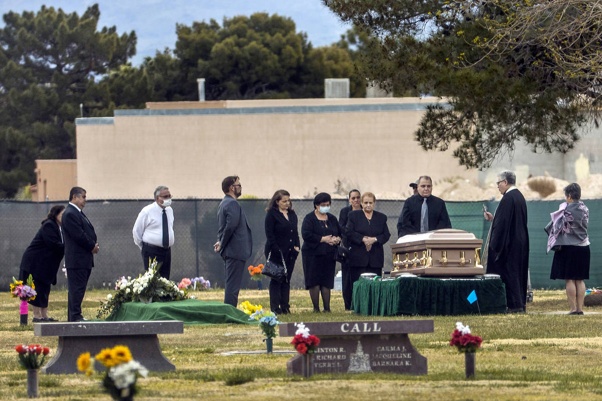 A funeral takes place at the Davis Funeral Home Cemetery on Monday, April 6, 2020, in Las Vegas ...