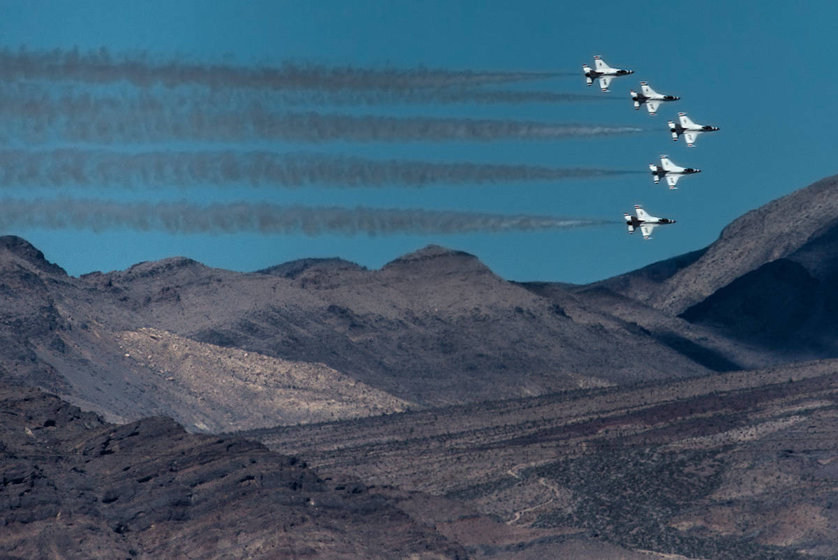 Six F-16 Fighting Falcons with the U.S. Air Force Air Demonstration Squadron Thunderbirds fly o ...
