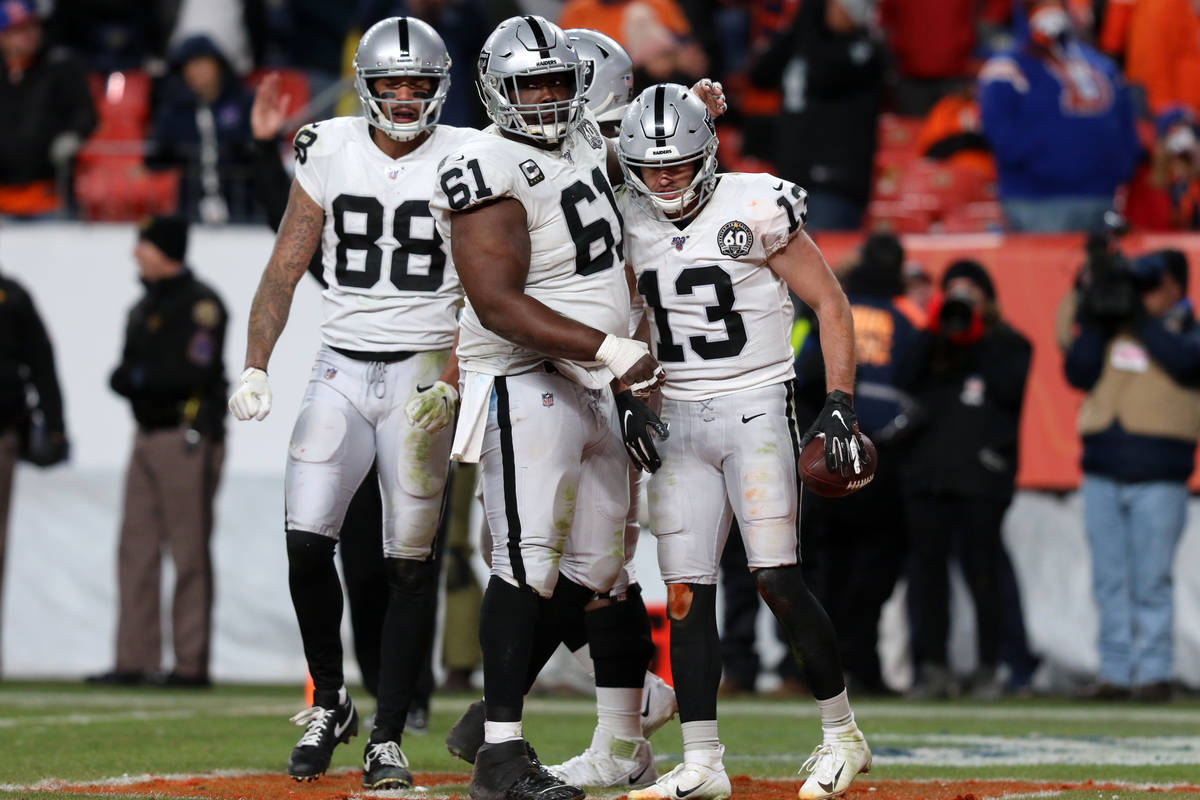 Oakland Raiders wide receiver Hunter Renfrow (13) celebrates his touchdown reception with wide ...