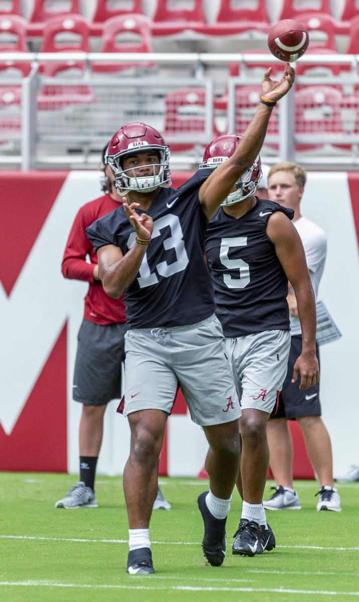 Alabama quarterback Tua Tagovailoa (13) works through drills in Alabama's fall camp fan-day col ...