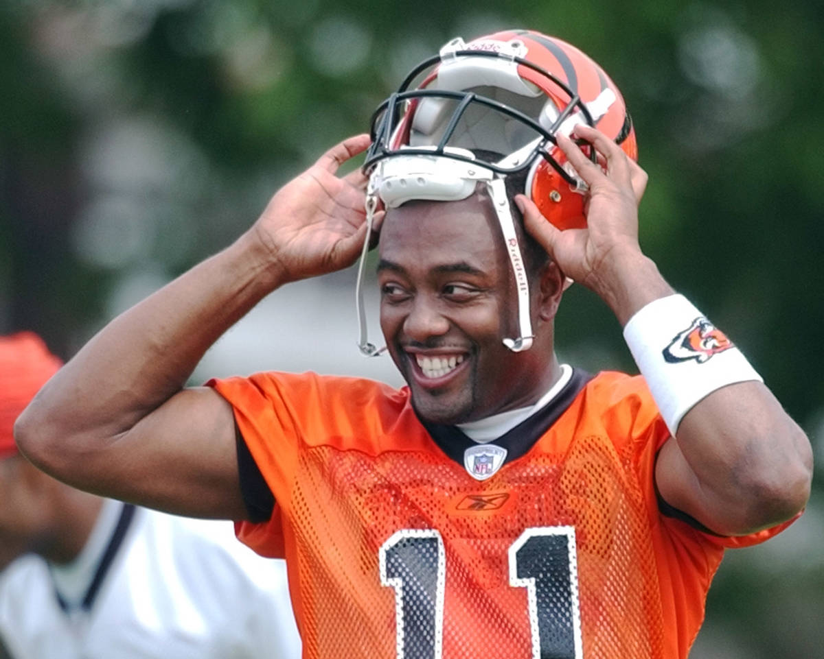 Cincinnati Bengals quarterback Akili Smith smiles during practice, Friday, July 26, 2002, at t ...