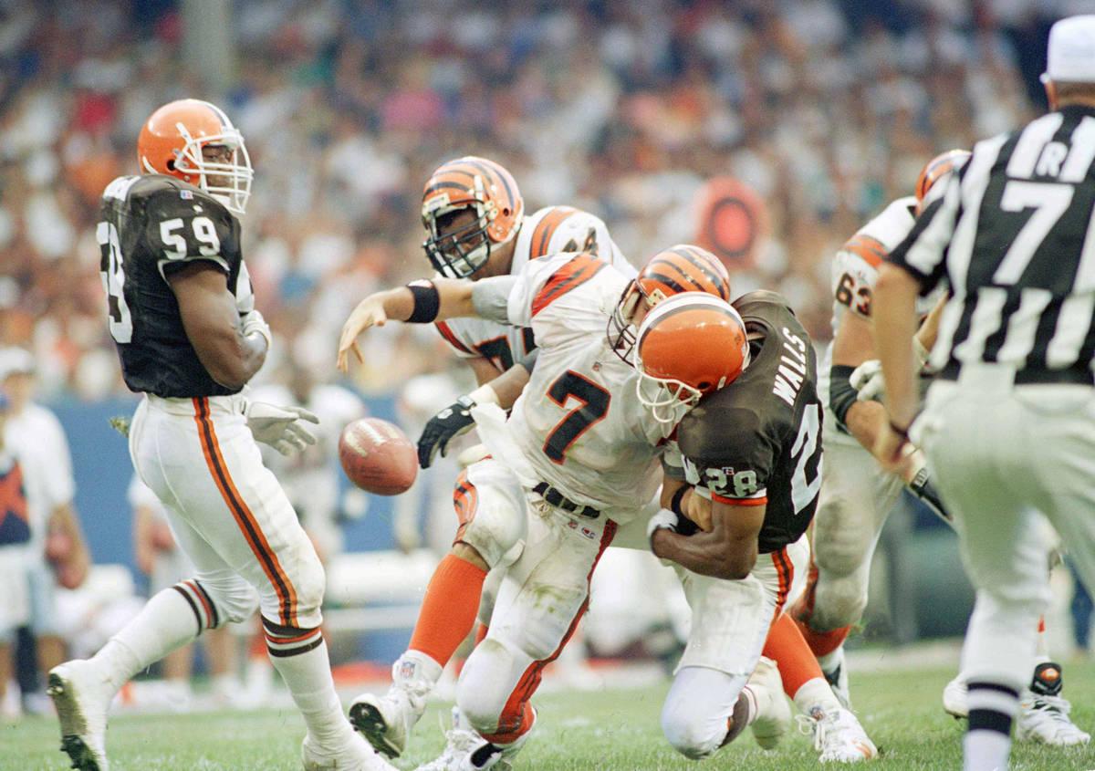Cincinnati Bengals quarterback David Klingler (7) loses the ball as he is sacked by Cleveland B ...