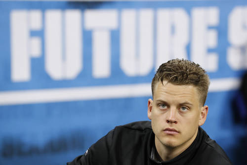 LSU quarterback Joe Burrow watches a drill at the NFL football scouting combine in Indianapolis ...