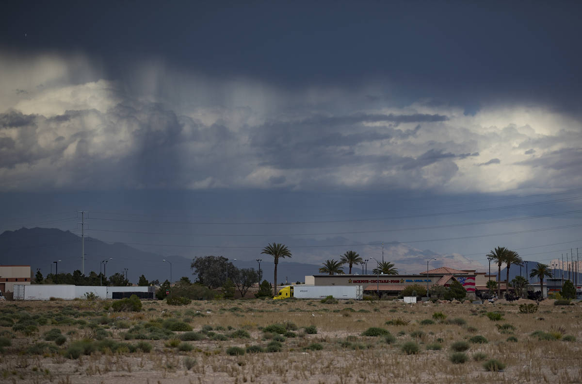 Rain and clouds seen from the southwest part of the valley in Las Vegas, Sunday, April 12, 2020 ...