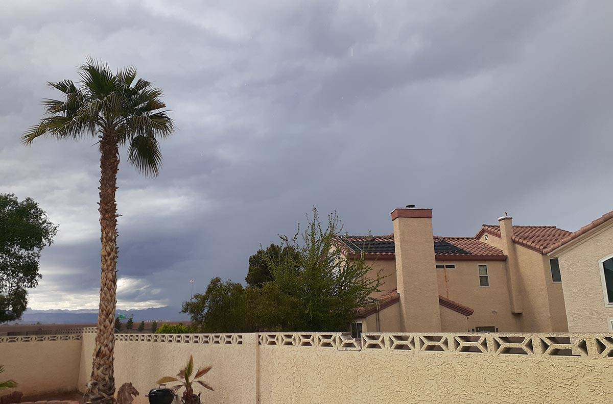 Dark clouds form near South Eastern Avenue and Windmill Lane in Las Vegas on Easter Sunday, Apr ...