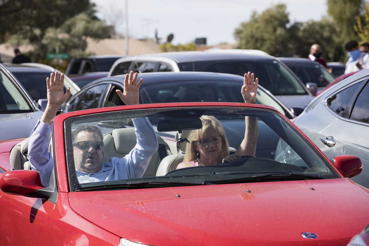 David Howard and his wife Tina Howard worship from their car at an Easter service in the parkin ...