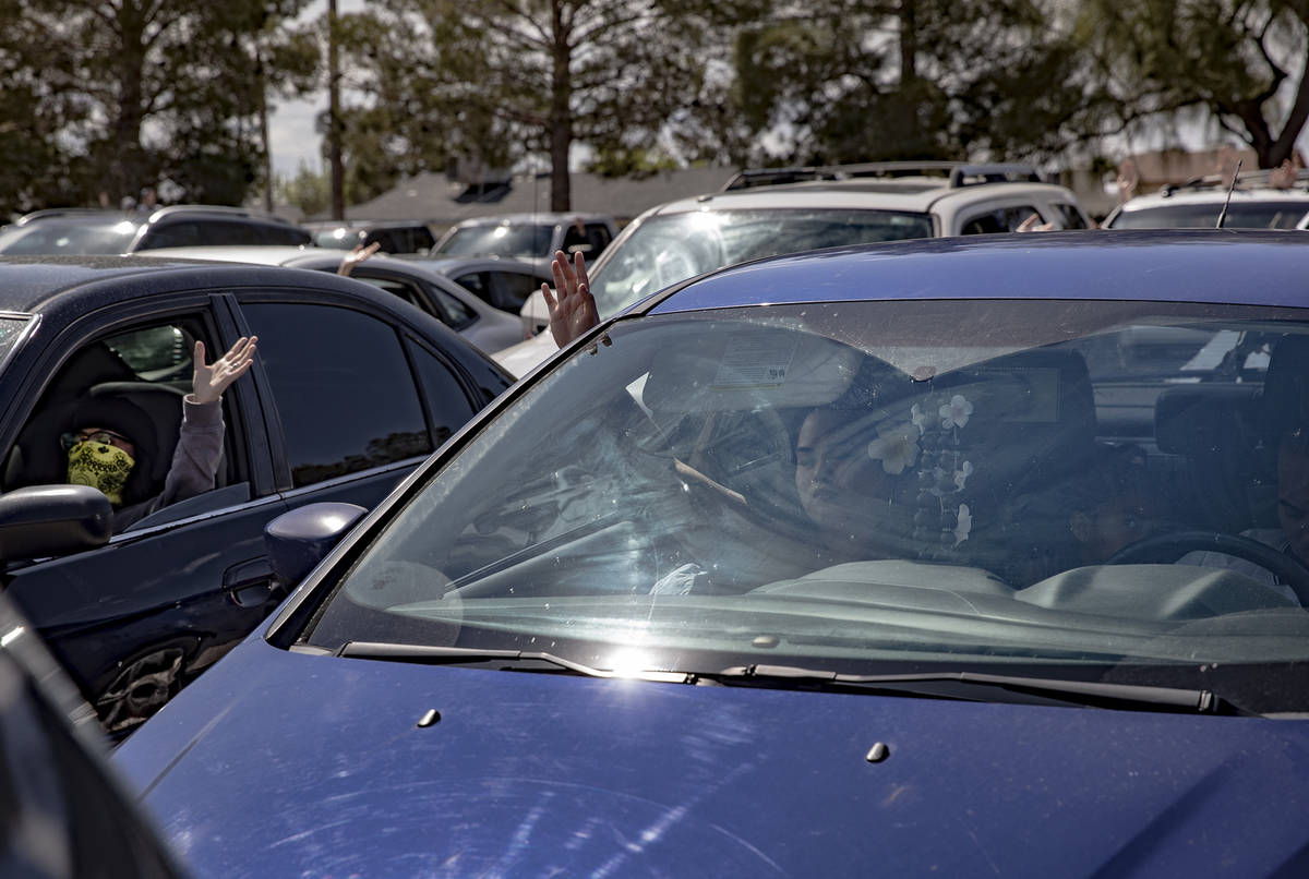 Guests attend an Easter service in the parking lot at International Church of Las Vegas in Las ...