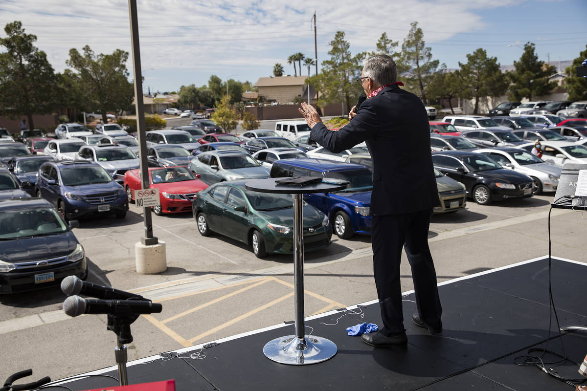 Pastor Paul Marc Goulet leads an Easter service in the parking lot at International Church of L ...