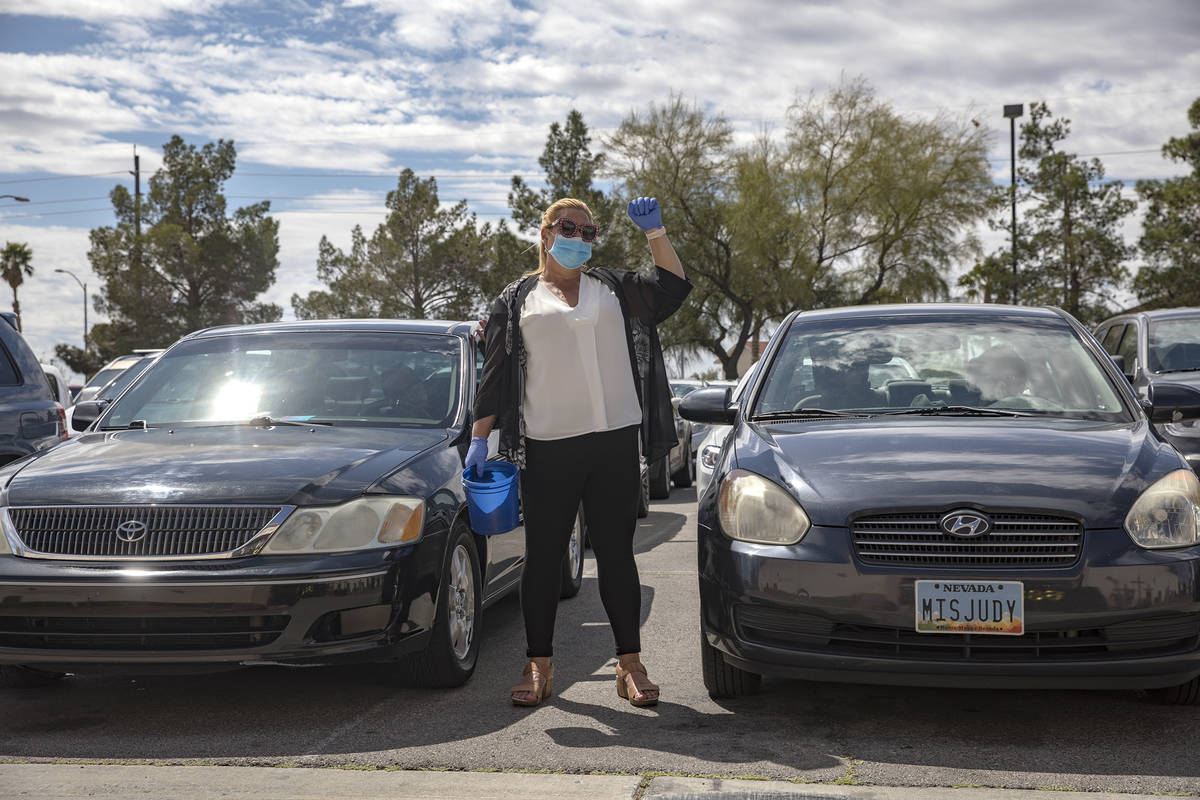 Usher Cathleen Snyder worships alongside guests in their cars at an Easter service in the parki ...