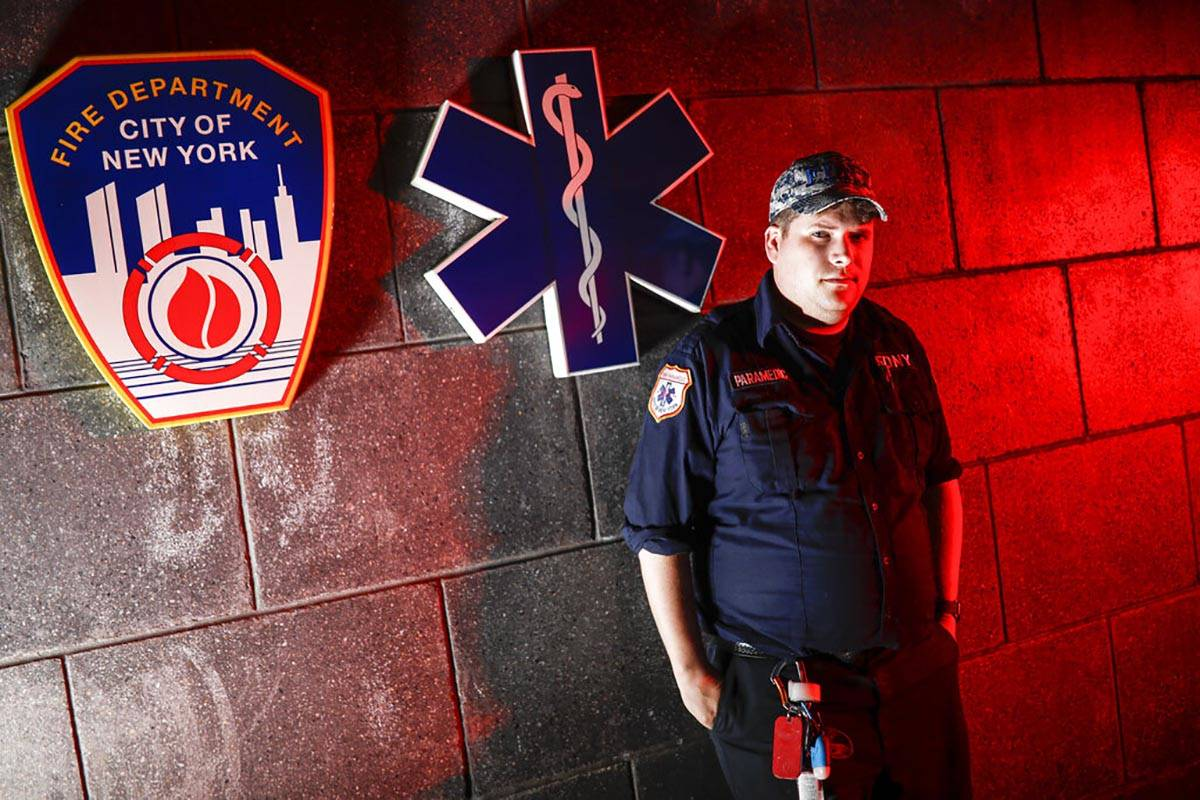 Paramedic Travis Kessel is photographed outside his station house after working a shift amid th ...