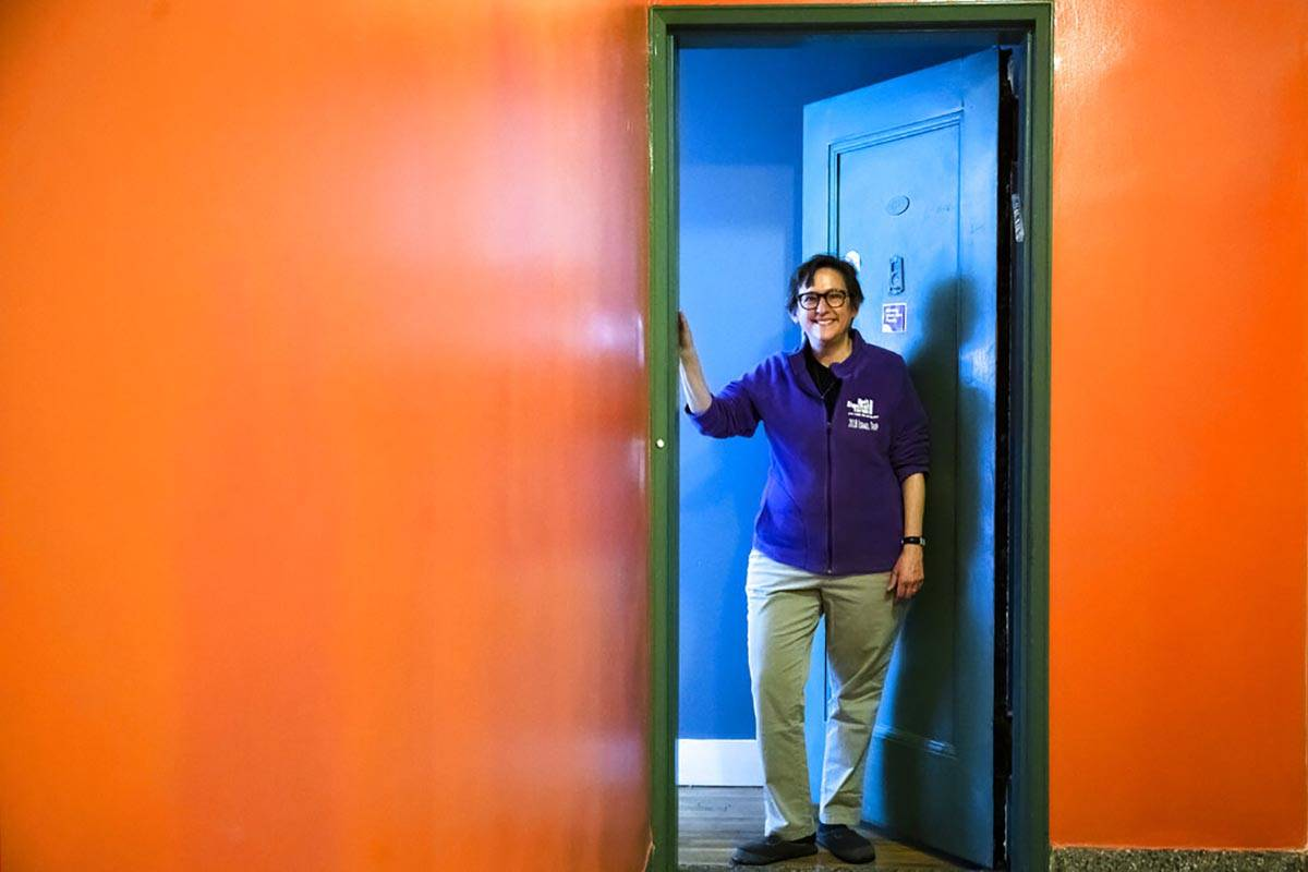 Rabbi Sharon Kleinbaum poses for a photograph at the door to her apartment in New York, Monday, ...