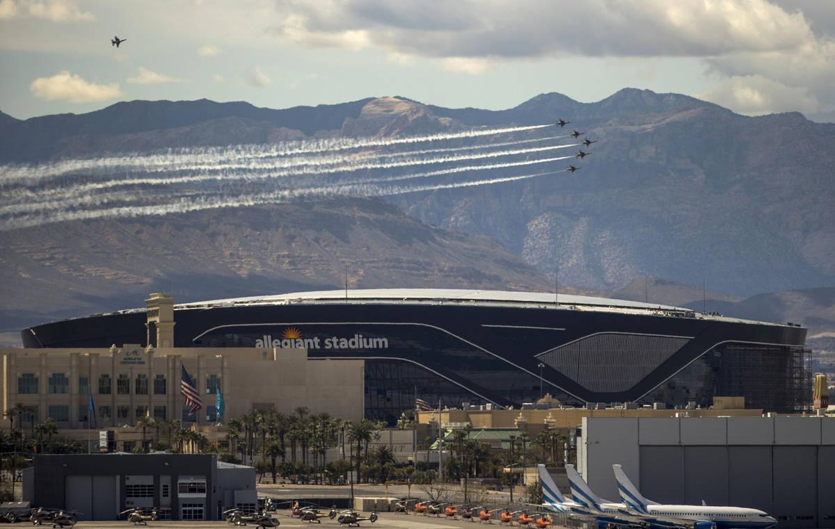 The U.S. Air Force Air Demonstration Squadron, the Thunderbirds, soar past Allegiant Stadium du ...