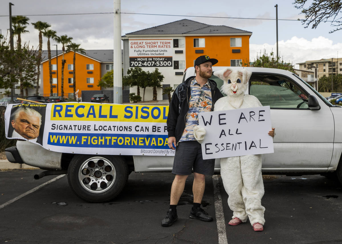 Cody Cunningham and Michelle Franco, in an Easter bunny costume, await the start of the Nevada ...