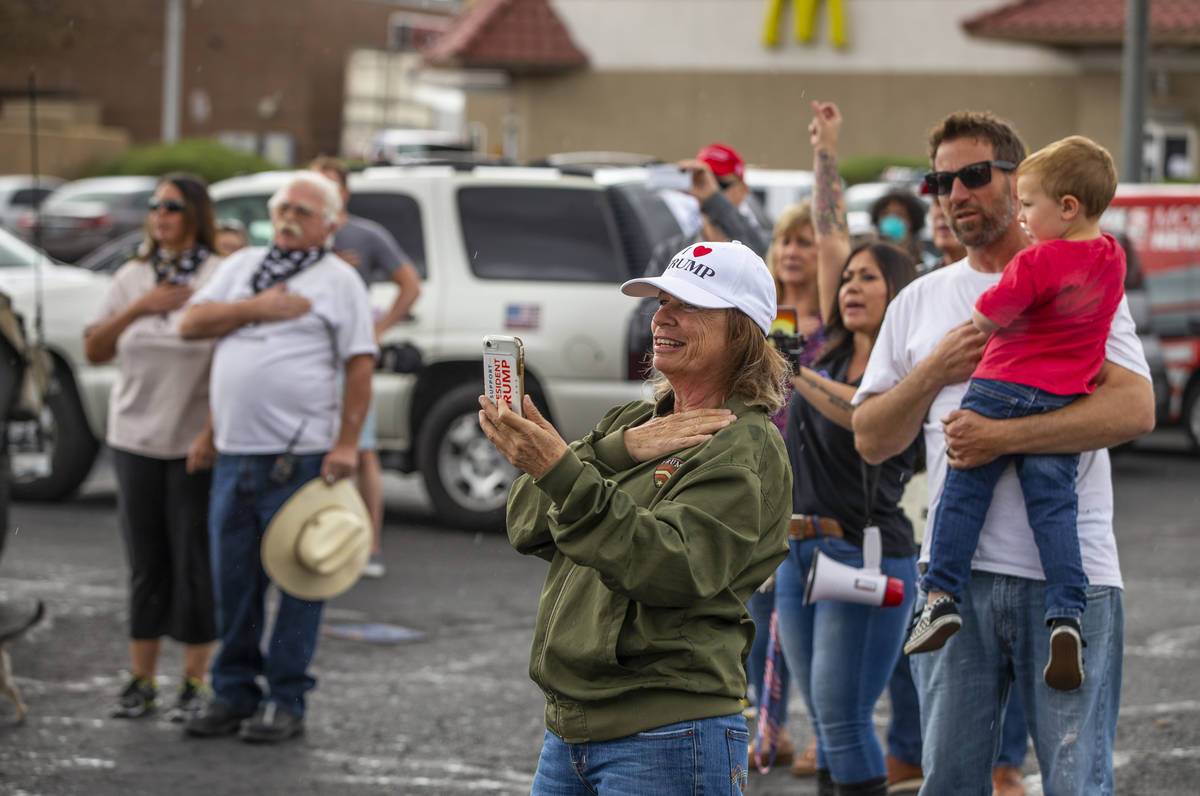 Participants recite the Pledge of Allegiance during the start of the Nevada Caravan Protest of ...