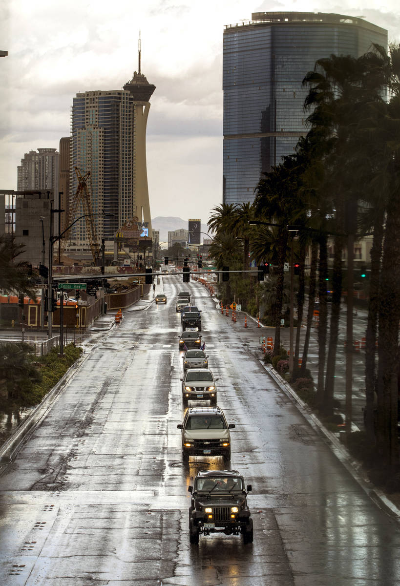 Vehicles make their way down the Las Vegas Strip during the Nevada Caravan Protest of Governmen ...