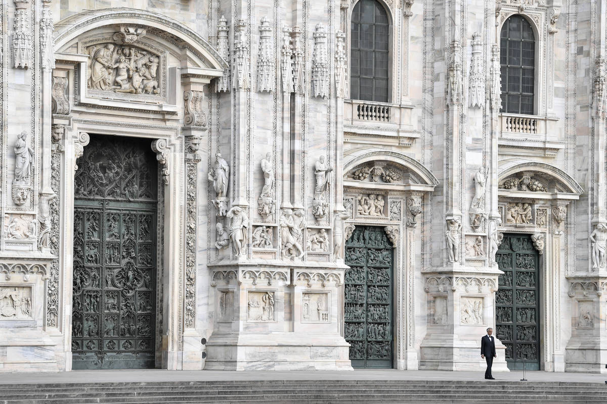Italian singer Andrea Bocelli performs outside the Duomo cathedral, on Easter Sunday, in Milan, ...
