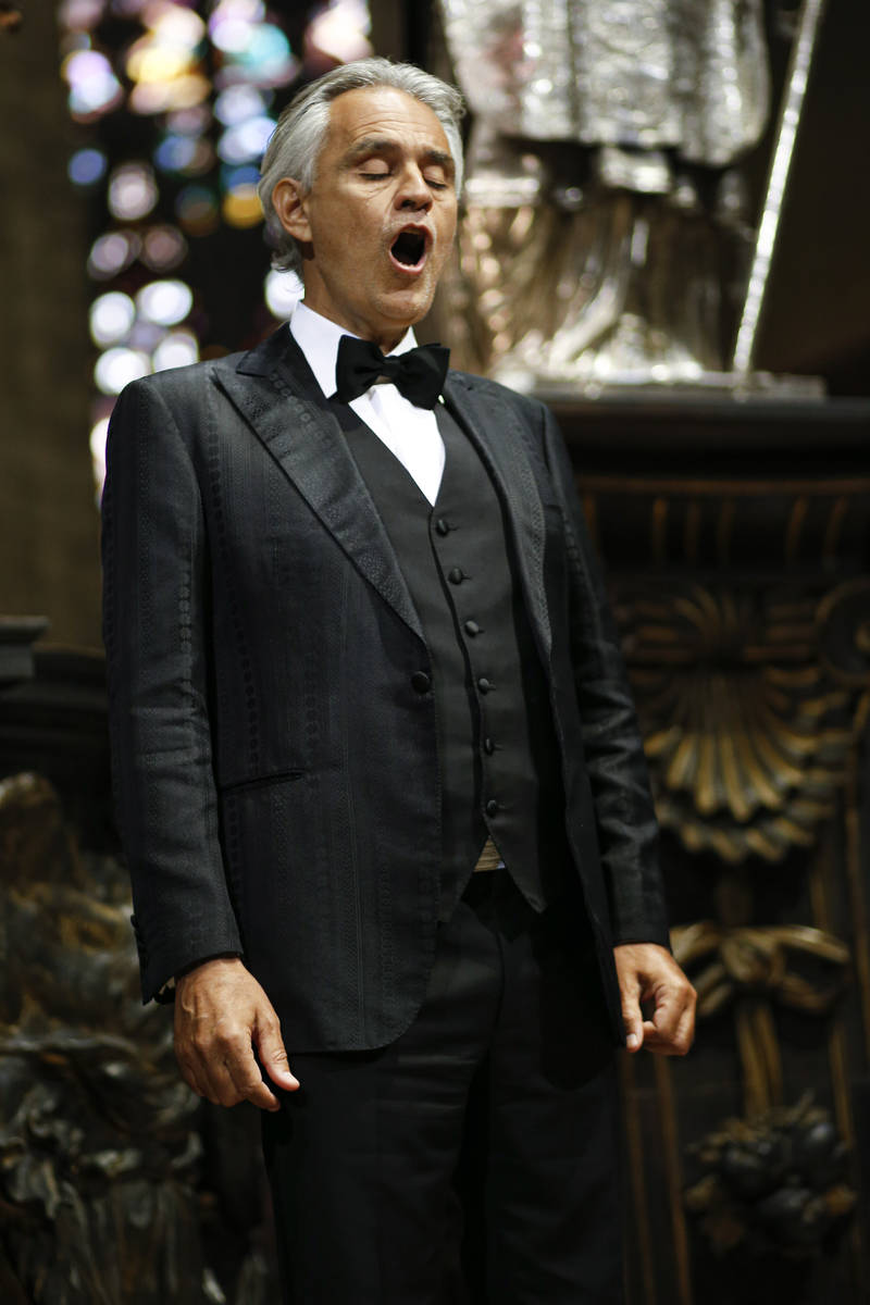 Italian singer Andrea Bocelli performs inside an empty Duomo cathedral, on Easter Sunday, in Mi ...