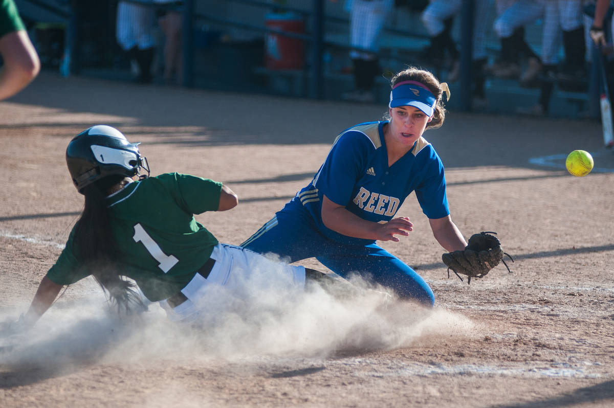 Palo Verde's Melissa Lacro slides home and scores as Reed's Jessica Sellers waits for the throw ...