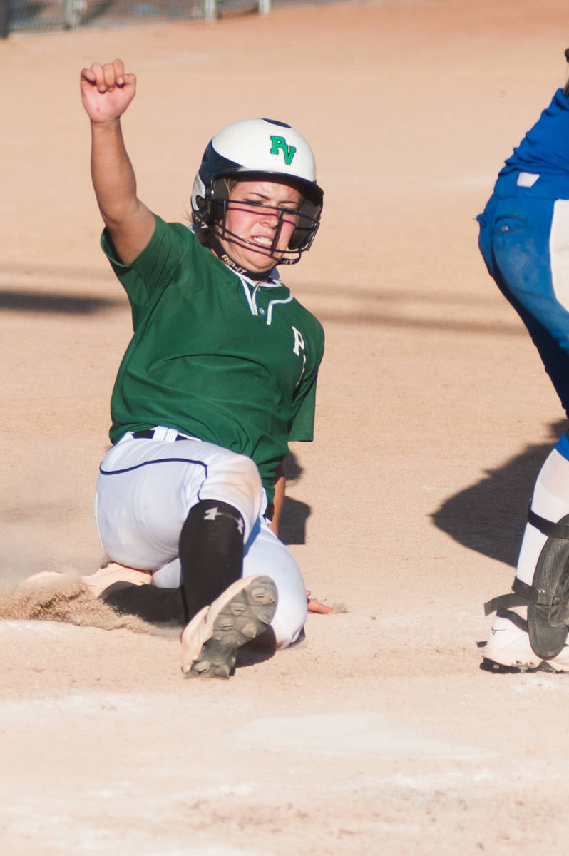 Palo Verde's Jordan Menke slides home and scores against Reed in the deciding game of the Divis ...