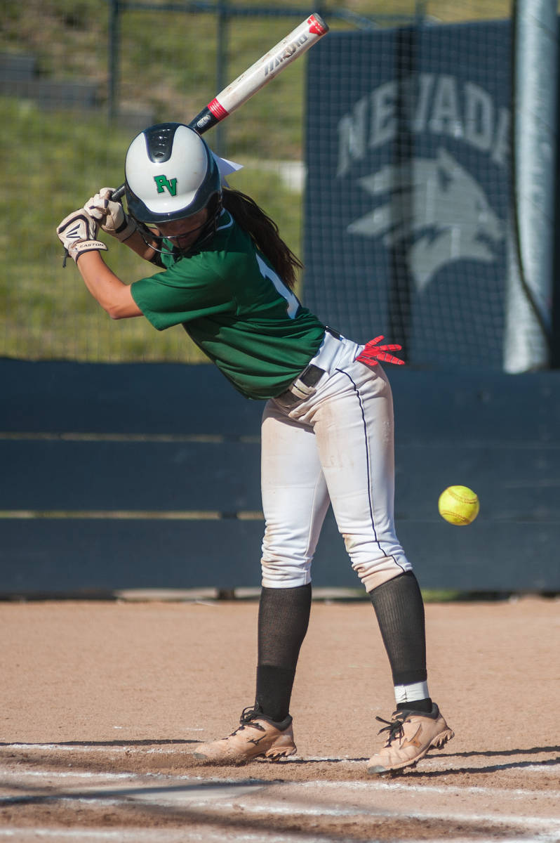 Palo Verde's Haley Harrison dodges a close pitch while playing against Reed in the deciding gam ...