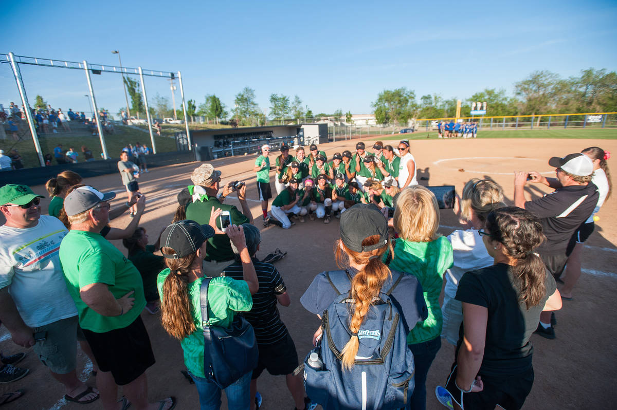 Palo Verde players pose for photos from family members after the team defeated Reed in the seco ...
