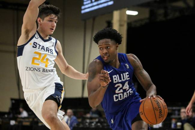 Delaware Blue Coats' Haywood Highsmith (24) drives past Salt Lake City Stars' Grayson Allen (24 ...