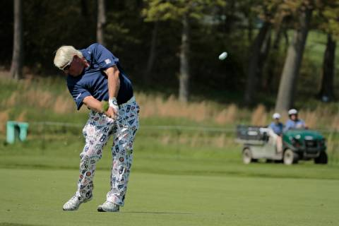 John Daly hits off the 16th fairway during the first round of the PGA Championship golf tournam ...