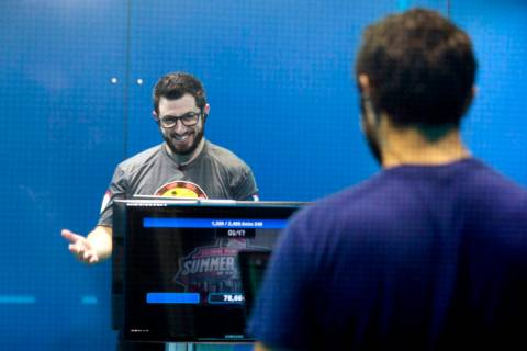 Phil Galfond, left, with the San Francisco Rush, reacts while playing video poker against Tim A ...