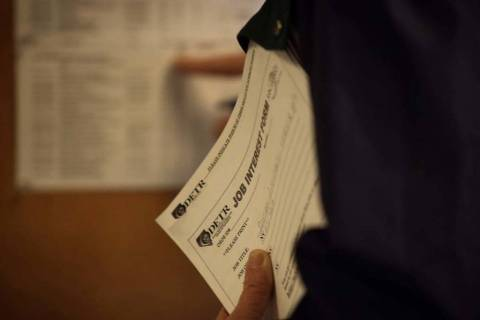 A man looks at an employment board at Nevada JobConnect, 119 South Water St., Henderson, Thursd ...