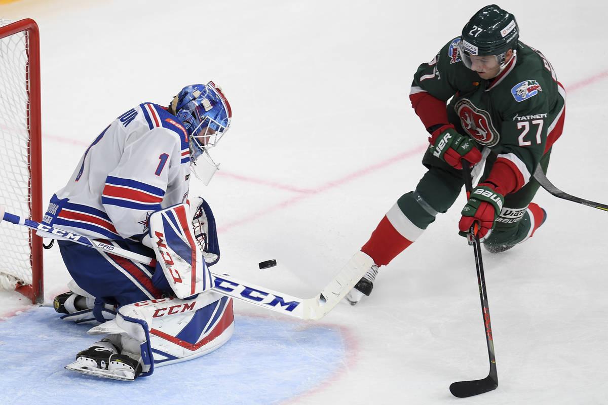 SKA's goaltender Alexei Melnichuk makes a save against Ak Bars' Kirill Petrov during the Kontin ...
