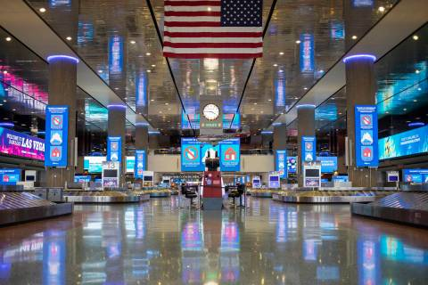 No travelers can be seen at baggage claim in Terminal 1 at McCarran International Airport on We ...