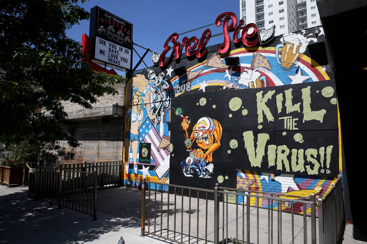 A mural by artists Jeff Davis and Dustin Hoots on the boarded up windows of Evel Pie on East Fr ...