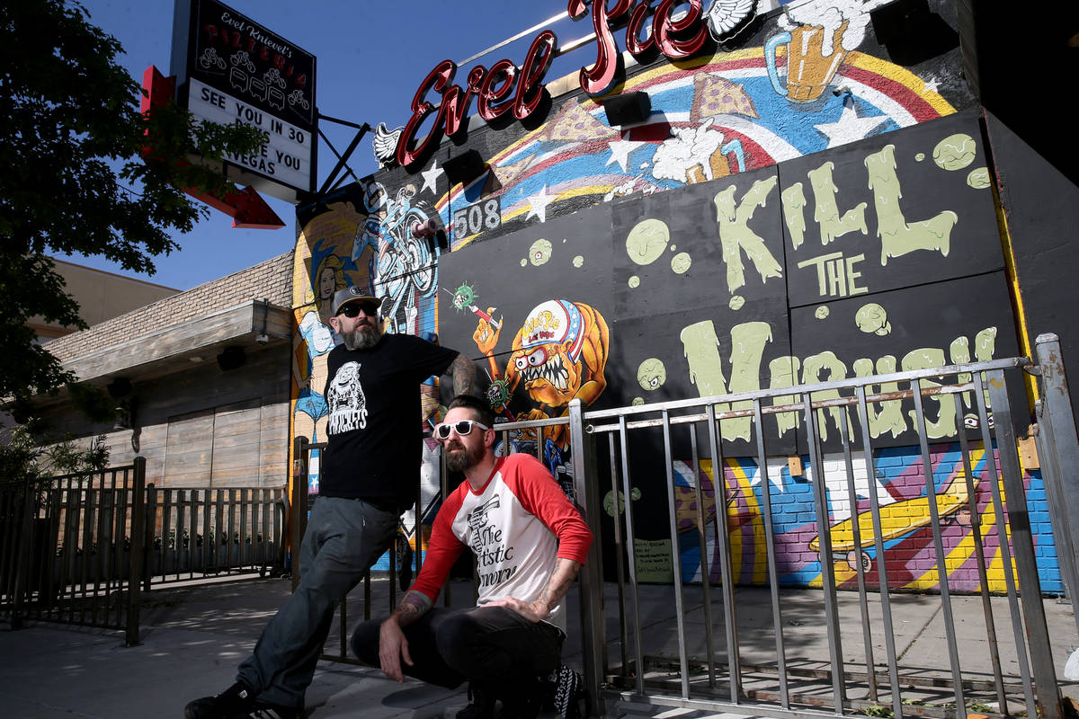Dustin Hoots, left, and Jeff Davis with their coronavirus mural on the boarded up windows of Ev ...