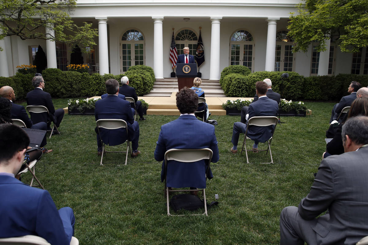 President Donald Trump speaks about the coronavirus in the Rose Garden of the White House, Tues ...