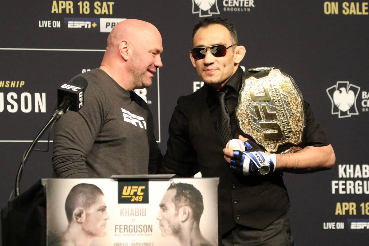 UFC president Dana White, left, speaks with UFC lightweight Tony Ferguson during the UFC 249 pr ...