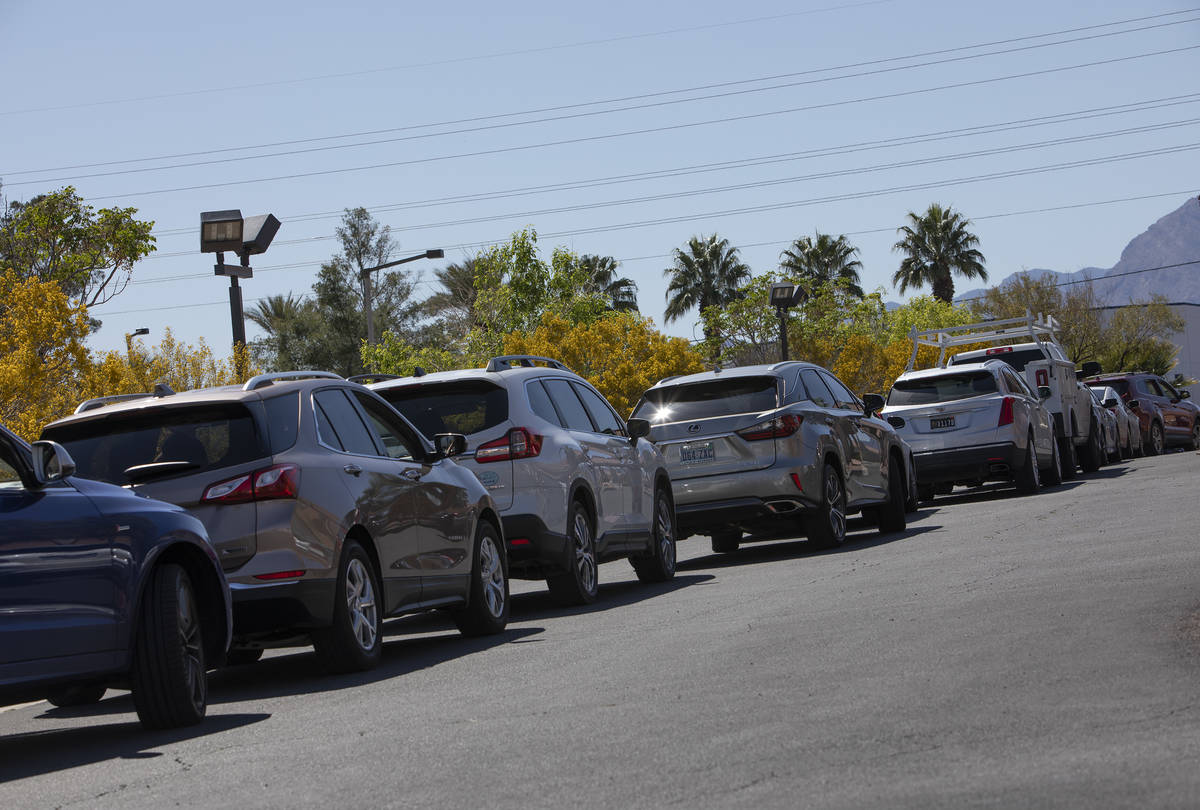 Cars line up for drive-through COVID-19 antibody testing outside PAM Speciality Hospital on Tue ...