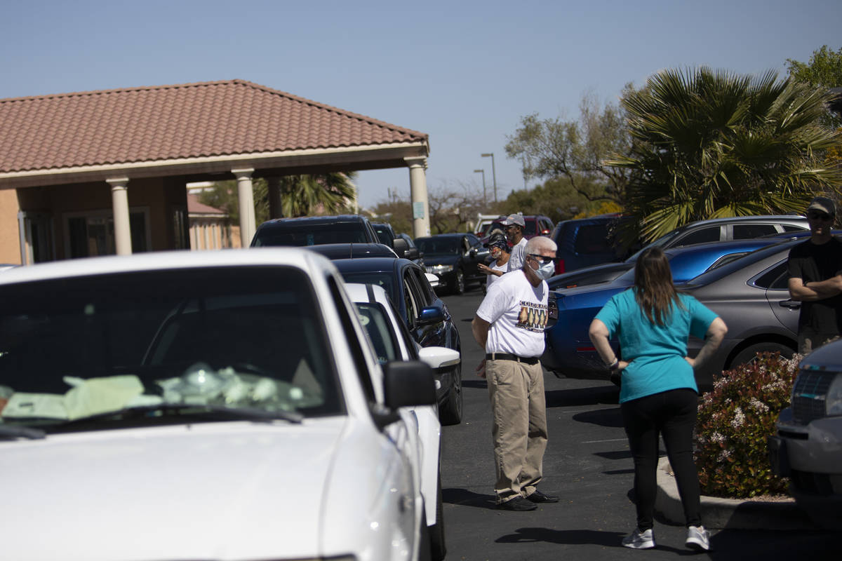 People seeking drive-through COVID-19 antibody testing, some of whom have been waiting outside ...