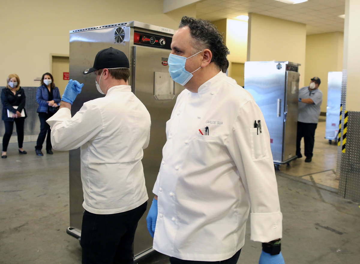 Andrew Carroll, left, executive chef at Catch Restaurant, and Carlos Guia, executive chef at Ar ...