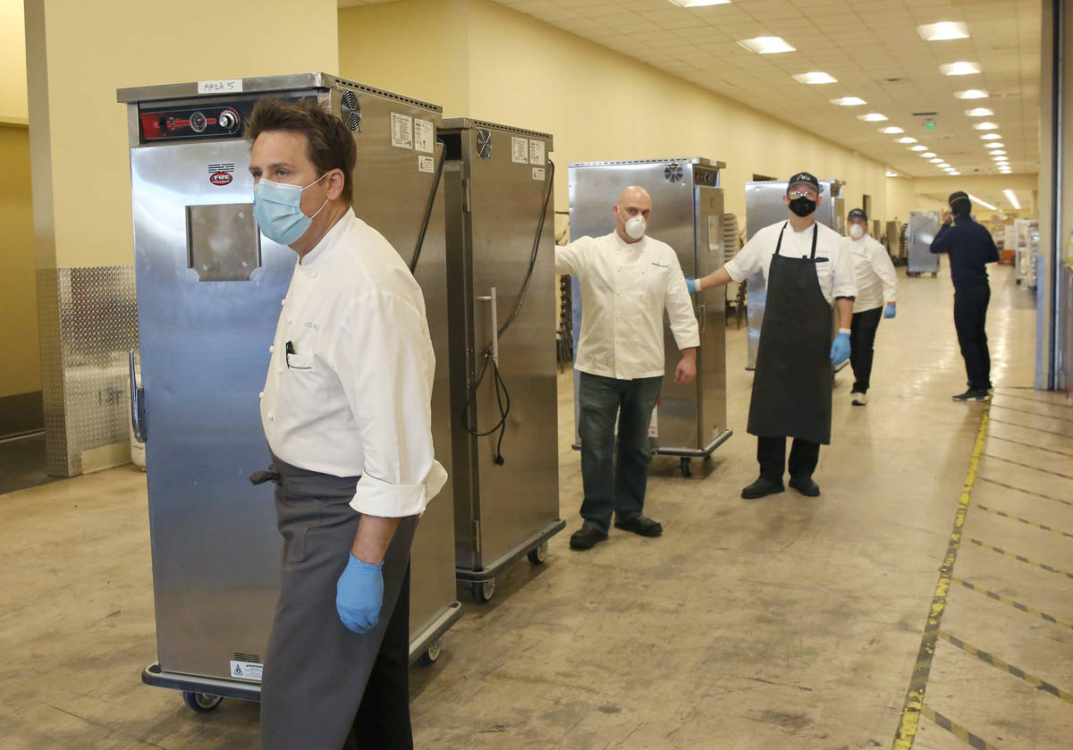 David Werly, front, executive chef at Aria hotel-casino, and other chefs prepare to load hot me ...