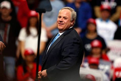 Interior Secretary David Bernhardt joins President Donald Trump as he speaks at a campaign rall ...