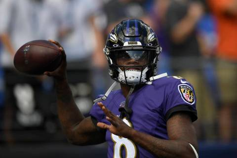 Baltimore Ravens quarterback Lamar Jackson (8) warms up prior to an NFL football game against t ...