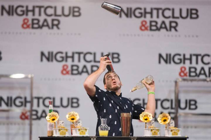 Harry Rivera performs in the flair bartending competition at the Nightclub and Bar Show on Tues ...