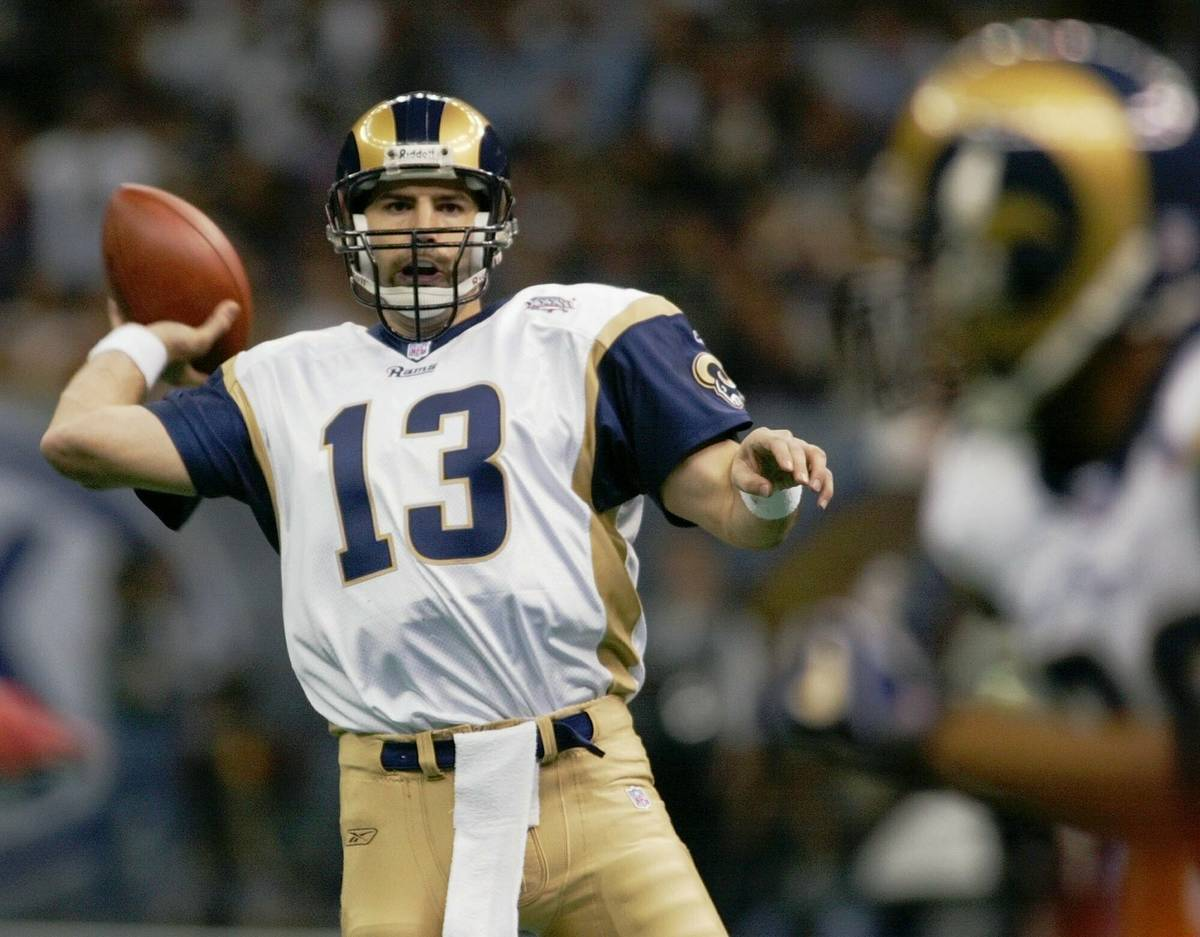 FILE- In this Feb. 3, 2002, file photo, St. Louis Rams quarterback Kurt Warner looks to pass to ...