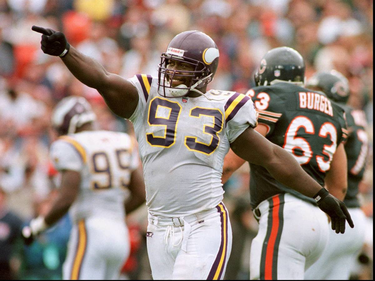 FILE - This Aug. 15, 1996, file photo shows Minnesota Vikings' John Randle celebrating after di ...