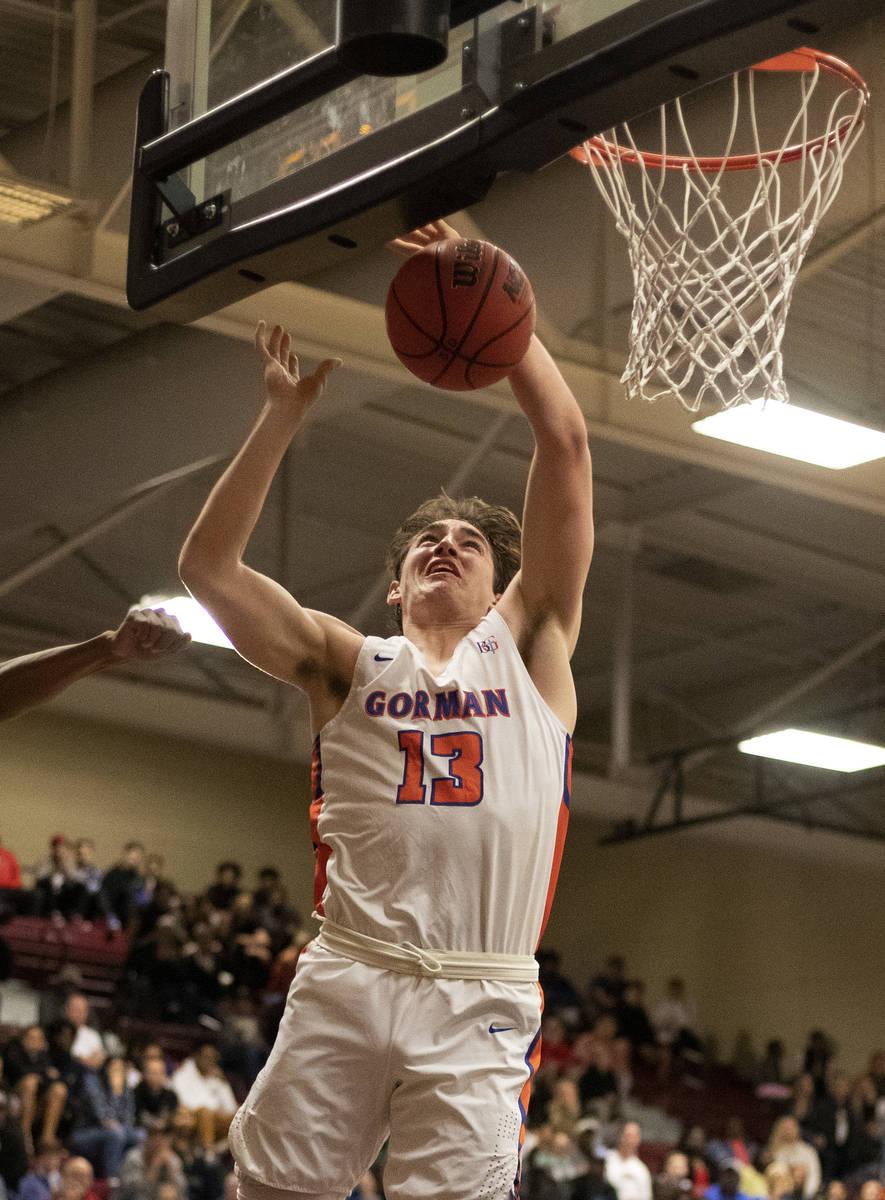Bishop Gorman's Braden Lamar (13) dunks the ball during the game against Durango at Desert Oasi ...