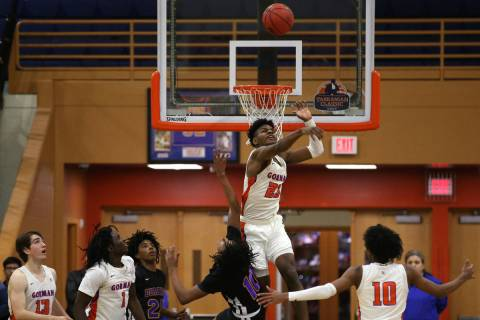 Bishop Gorman forward Mwani Wilkinson (23) blocks a shot by in the Durango guard Keshon Gilbert ...