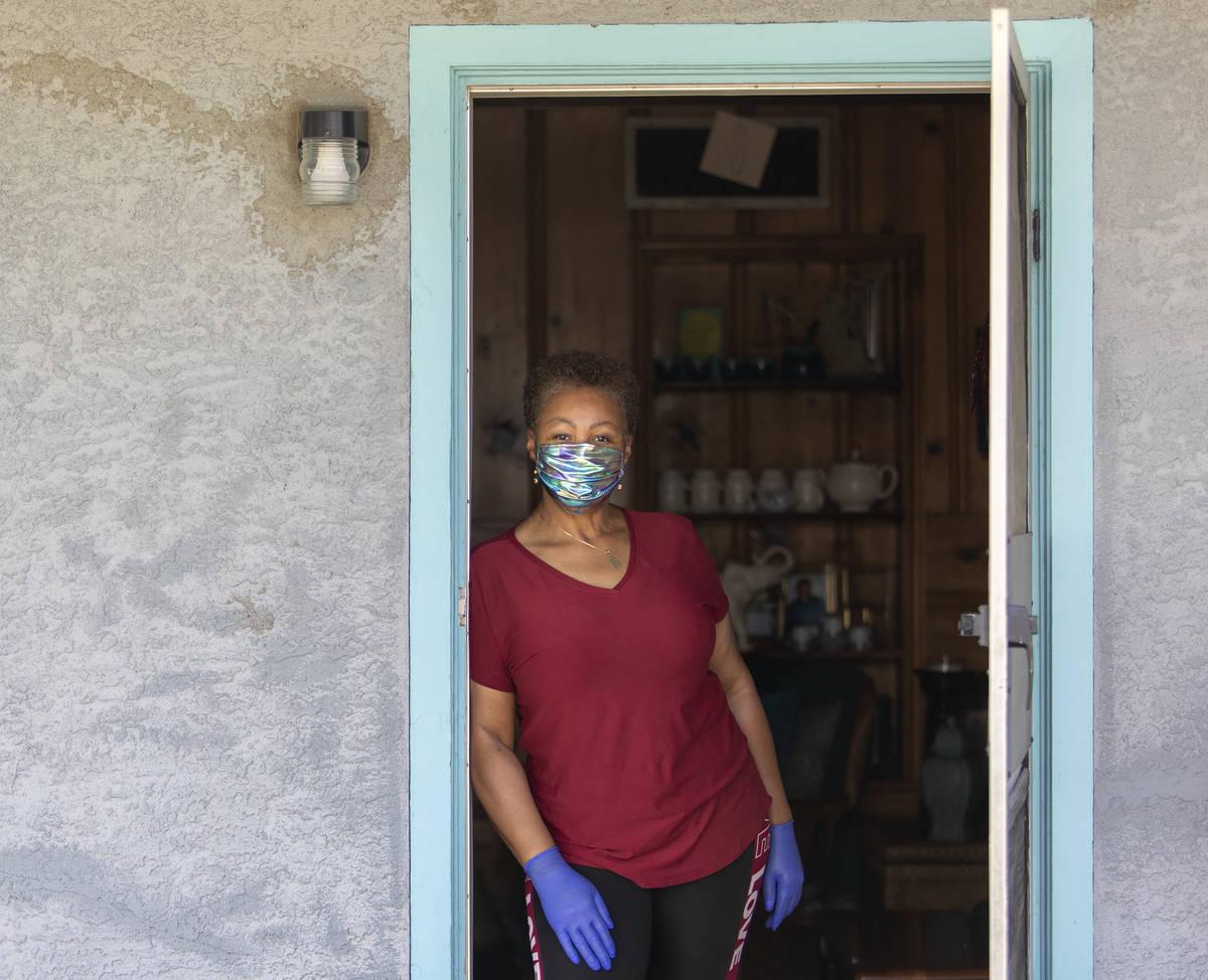 Kismet Evans stand for a portrait in her doorway on Thursday, April 16, 2020, in Las Vegas. Eva ...